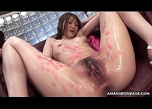 Candle dripped Oriental slut sucking on rods and she likes the freakiness