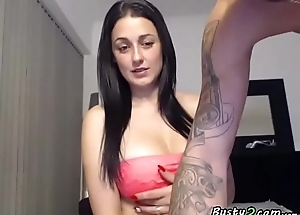 Busty brunette playing around a dude front the webcam