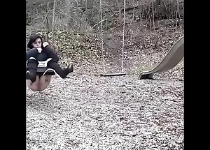 Legal age teenager pees on their way swing